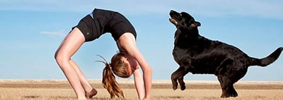 Woman doing yoga with her dog