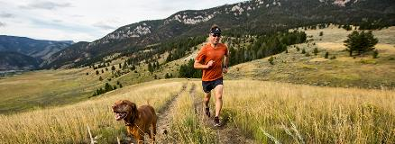 man running with dog