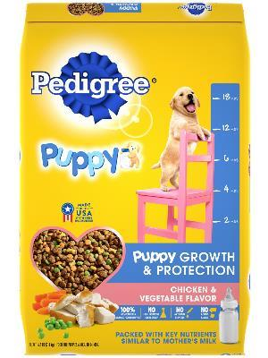 front of yellow bag of pedigree puppy growth & protection chicken & vegetable flavored dog food